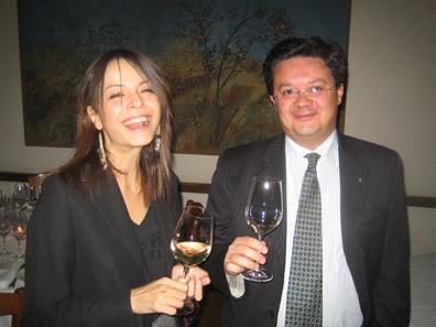 Domenico Valentino's Amelia Di Marco shares an aperitivo of LINI910 Labrusca Bianco with Fabrizio Santarelli at I Trulli.